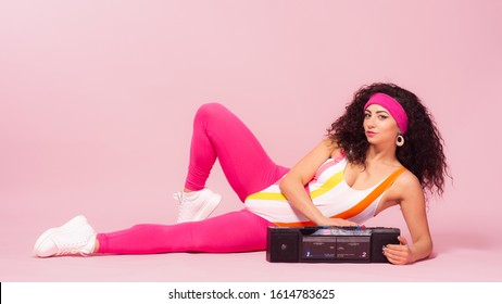 Color background with sport girl, 80s, aerobic. Toned photo