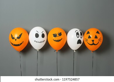 Color balloons for Halloween party on gray background