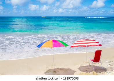Color Beach umbrellas and chair by the ocean in sunny day