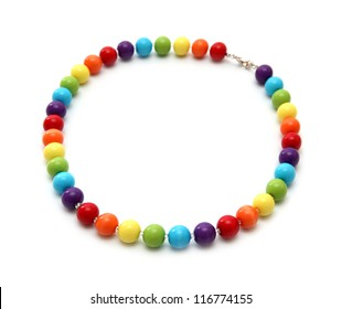 Color beads close up on a white background.