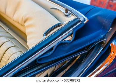 Color and beauty of vintage cars. Convertible top of an old luxury automobile. Leather seats. Vibrant colors.