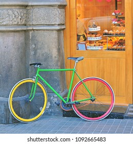 Color bike at shop in street of big city