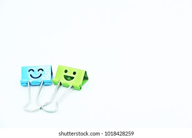 Color binder clip smiles icon on white background