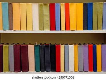 Color books on the shelf in the library