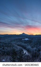 Color Breaks Over Mt Hood and Frozen Forest Below in central Oregon