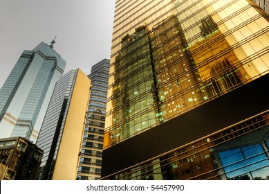 Color business office buildings exterior with glass in day.