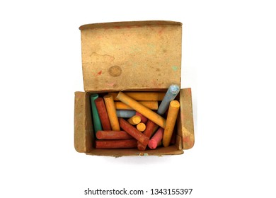color chalks stick in old paper box isolated on white background