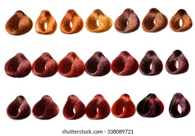 Color chart of swatches of hair in a salon showing the various tints and dyes available in a hairstyling, beauty and fashion concept