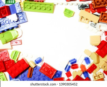 Color children's bright background of cubes designer. Abstract background of kid's toys. Close-up of bright plastic blocks. Top view.
