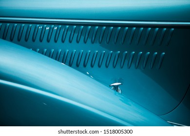 Color close up of the air vents of a blue vintage classic car.