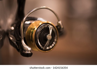 Color close up shot of a new fishing reel with shallow depth of field.