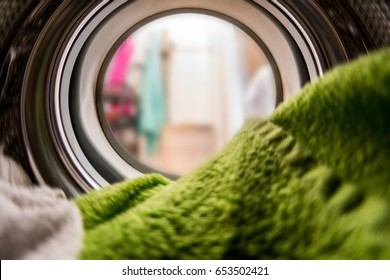 Color clothes in washing machine. inside view