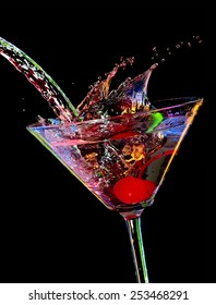 Color cocktail with a cherry splash, close up