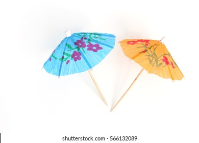 color cocktail umbrellas on white background