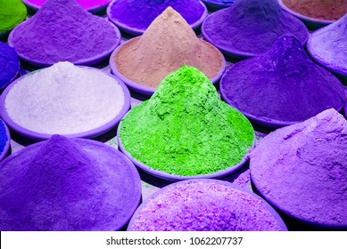 Color coloring dye powder piles in Indian market purple, violet, green