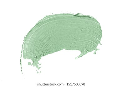 Color correcting concealer stroke isolated on white background. Light green corrector cream smudge smear swatch sample. Makeup base foundation creamy texture