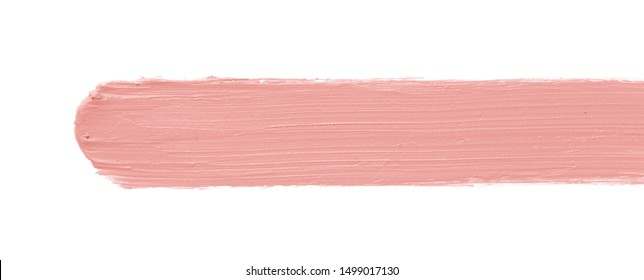 Color corrector stroke isolated on white background. Peach color correcting cream concealer smudge smear swatch sample. Makeup base foundation creamy texture