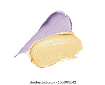 Color corrector strokes isolated on white background. Yellow and lilac color correcting concealer cream smudge smear swatch sample. Makeup cosmetic creamy texture