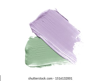 Color corrector strokes isolated on white background. Mint green and light purple colour correcting cream concealer smudge smear swatch sample. Makeup foundation creamy texture