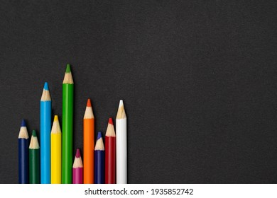 Color crayons on dark background