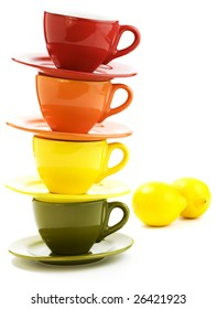 Color cups and lemons an white background
