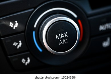 Color detail with the air conditioning button inside a car