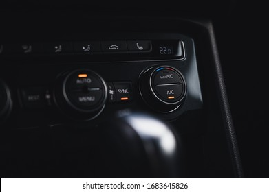 Color detail with the air conditioning button inside a car. Car interior. Car air condition.