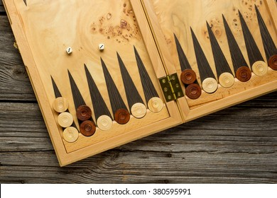 Color detail of a Backgammon game with two dice close up.