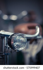 Color detail image of the headlight of a bicycle.