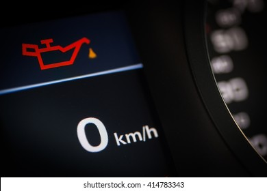 Color detail of the oil warning symbol in a car.