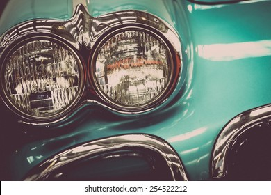Color detail on the headlight of a vintage car.