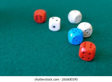 Color dice on the green paneling - background