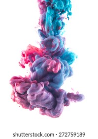 Color drop underwater. Ink swirling in water. Cloud of silky ink in water isolated on white background. Colorful ink in water, ink drop. Abstract flowers. Pink and blue.