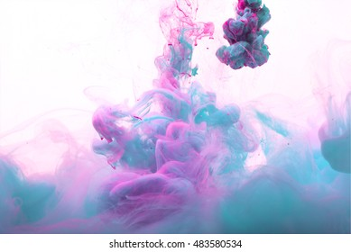 Color drop in water, photographed in motion. Ink swirling in water. Cloud of silky ink in water isolated on white background. Colorful ink in water, ink drop. Action painting.