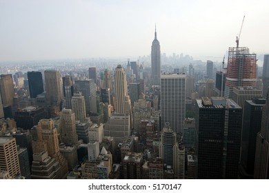 Color DSLR image of New York City Skyline, from above looking south, with Empire State Building and a hazy urban smog sky. Horizontal with copy space for text.