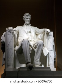 Color DSLR picture of the Statue of Abraham Lincoln at the Lincoln Memorial, at night.  The symbol is a popular tourist destination, though no people are seen.  Vertical with copy space for text.
