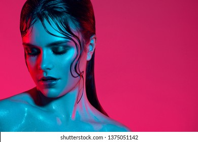 Color fashion woman neon lights. Rainbow make-up, portrait of a girl isolated on a bright background. Colorful color scheme