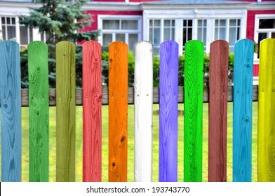 color fence beyond the house