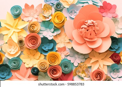 Color flowers paper background. Decorative paper flowers.