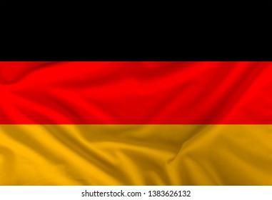 color German national flag on draped textile, background