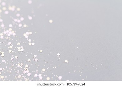 Color glitter on light background - macro photo