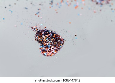 Color glitter on light background - heart shape