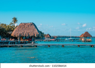 Color graded picture of a pier with clouds and blue water at the Laguna Bacalar, Chetumal, Quintana Roo, Mexico