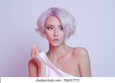 color hair beautiful young woman.sensual blond girl with hairstyle and make-up
