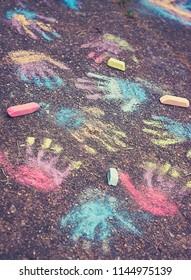 Color hands prints on pavement