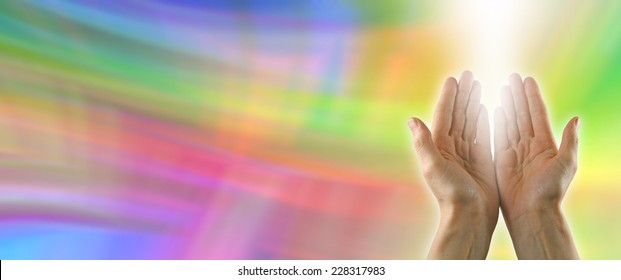 Color healing website banner  -  Color healing website banner with healer's hands outstretched palm up and a shaft of white energy