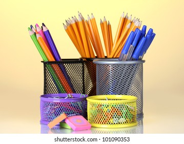 Color holders for office supplies with them on bright background