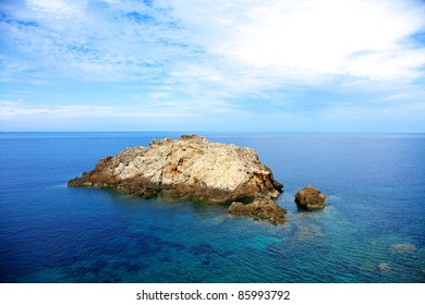 Color horizontal image of a mountain in the middle of the sea. Summer shot of and island.
