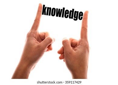 """Color horizontal shot of a of a hand squeezing the word """"knowledge""""."""