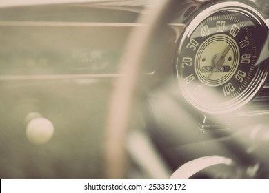 Color horizontal shot of the speedometer of a vintage car.